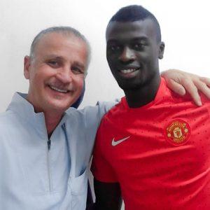 Il dentista Gianfranco Aiello con un calciatore suo paziente