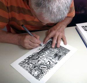 Fabio Sironi, l'illustratore del Corriere della Sera, al lavoro
